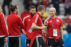 LILLE, FRANCE - Friday, July 1, 2016: Wales' David Cotterill jokes with Chris Gunter as they walk on the pitch ahead of the pre-match warm-up before the UEFA Euro 2016 Championship Quarter-Final match against Belgium at the Stade Pierre Mauroy. (Pic by Paul Greenwood/Propaganda)