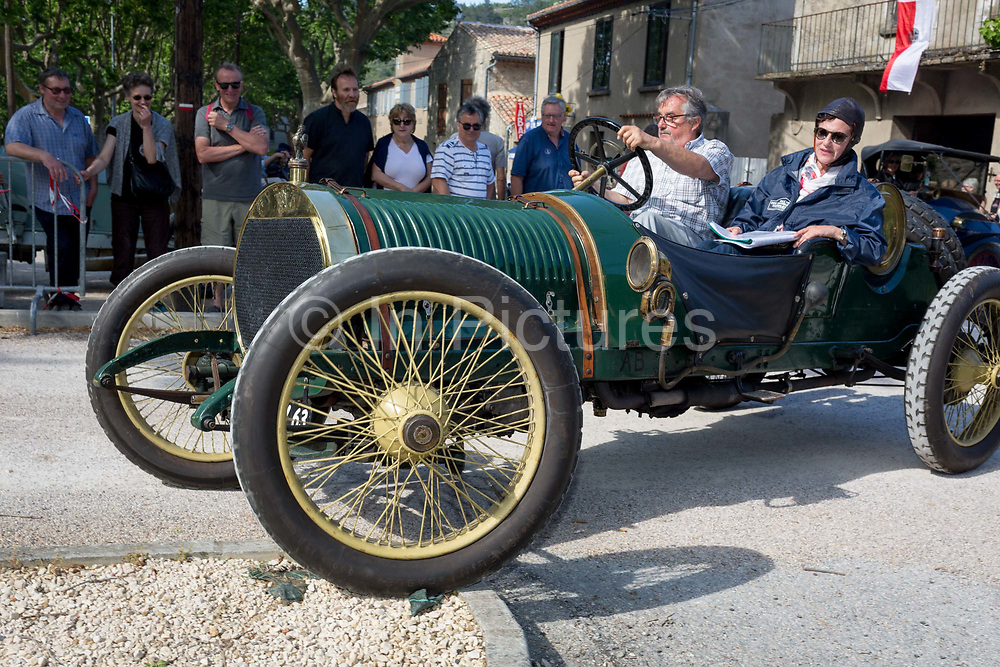 A visiting vintage car leaves a French village, during a three-day rally journey through the Corbieres wine region, on 26th May, 2017, in Lagrasse, Languedoc-Rousillon, south of France. Lagrasse is listed as one of Frances most beautiful villages and lies on the famous Route 20 wine route in the Basses-Corbieres region dating to the 13th century.
