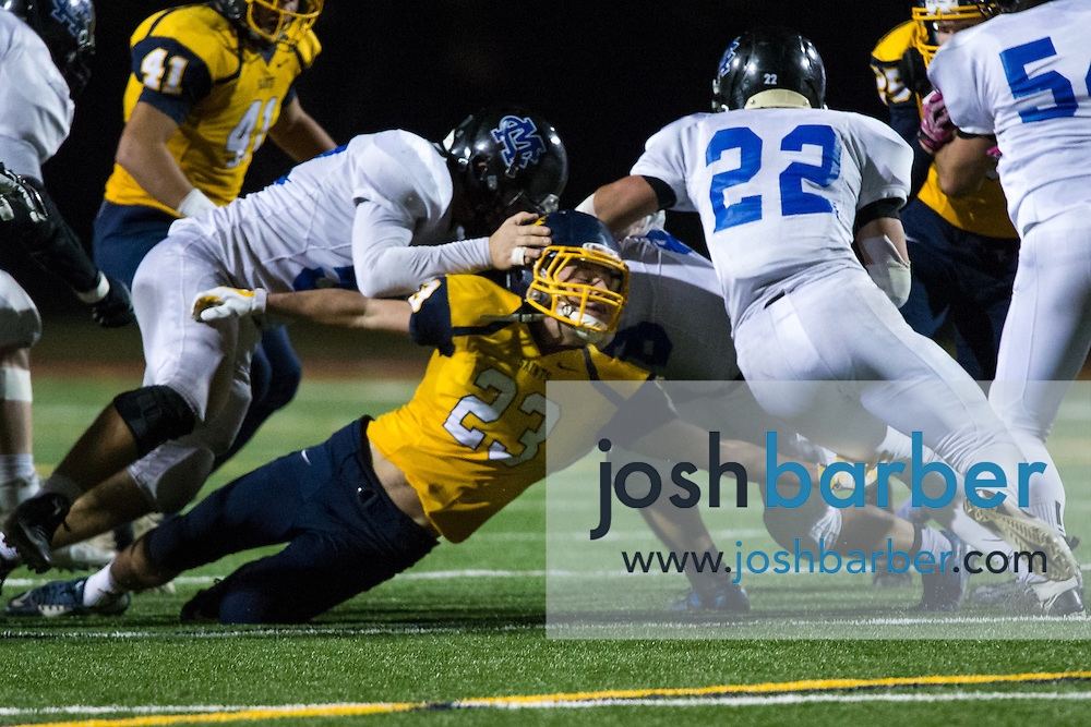 Crean Lutheran's Nick Ellwein (23), Calvary Chapel of Murrieta's Micah Roth (22) during the CIF-SS East Valley Divison Second Round  at Irvine High School on Friday, November 20, 2015 in Irvine, California. (Photo/Josh Barber)