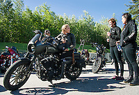 Samantha Campana and Leticia Cline with the Orlando Iron Lilies with Taylor Galvin and Deanna Warwick at Laconia Harley Davidson Tuesday morning before heading out for their group ride to the Kancamagus Highway.   (Karen Bobotas/for the Laconia Daily Sun)