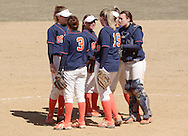 SUNY Orange softball players meet on the mound before the start of an inning against Gloucester County College on March 29, 2008.