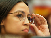 Rep. Alexandria Ocasio-Cortez (D-NY) listens at a Congressional hearing examining lessons from the civil rights movement on combating efforts to suppress the right to vote and how many of these lessons are particularly urgent in the face of similar voter suppression efforts today.