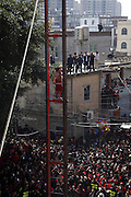 PUTIAN, CHINA - FEBRUARY 15: <br /> <br /> Chinese Man Climbs Ladder made from Blades <br /> <br /> A Chinese man climbs a ladder made out of 21 blades at Shanting Town on February 15, 2017 in Putian, Fujian Province of China. The Chinese man with naked feet wearing traditional Chinese bellyband climbs up a 17-metre-high ladder to toss cooper coins into the crowd, which may bring good luck to local people. It is a traditional folk activity originated from Ming Dynasty and local people hold this activity to pray for peace next year. <br /> ©Exclusivepix Media