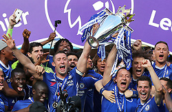 File photo dated 21/05/17 of Chelsea's Gary Cahill (centre left) and John Terry (centre right) lifting the Premier League trophy. A strong end to the Premier League season from London clubs Chelsea, Arsenal and Tottenham helped dent profits at William Hill in the first half of the year.