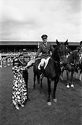 """06/08/1987<br /> 08/06/1987<br /> 06 August 1987<br /> RDS Horse Show, Ballsbridge, Dublin. The Jameson Whiskey International. Picture shows Comandant Gerry Mullins on """"Limerick"""", winner of the  Jameson Whiskey International receiving the trophy from Marie Cummins and her husband Michael, Managing Director, Irish Distillers Sales Company. Jameson's, Irish, Whiskey, jameson,"""