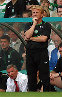 Photo: Paul Thomas.<br /> Glasgow Celtic v Manchester United. Pre Season Friendly. 26/07/2006.<br /> <br /> Celtic manager Gordan Strachan looks on, with Manchester manager Sir Alex Ferguson in the background.