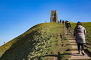 Families use the concrete paths, climbing to Glastonbury Tor, the ruins of St Michaels tower that sits on top of the hill in Glastonbury, Somerset. <br /> A prominent hill overlooking the Isle of Avalon, Glastonbury and the Somerset Levels. It has been a site of religious significance for over 1000 years and is considered one of the most spiritual sites in the United Kingdom, especially for Pagans. (photo by Andrew Aitchison / In pictures via Getty Images)