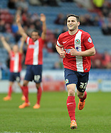 Craig Conway of Blackburn Rovers celebrates scoring the 3rd goal during the Sky Bet Championship match at the John Smiths Stadium, Huddersfield<br /> Picture by Graham Crowther/Focus Images Ltd +44 7763 140036<br /> 15/03/2014
