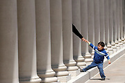 A boy tries to pull his father through the columns that line the courtyard of the Legion of Honor Museum in San Francisco's Lincoln Park. The museum honors California's fallen from World War I.