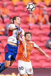 October 22, 2017 - Brisbane, QUEENSLAND, AUSTRALIA - Nigel Boogaard of the Jets (#4, left) and Brett Holman of the Roar (#10) compete for the ball during the round three Hyundai A-League match between the Brisbane Roar and the Newcastle Jets at Suncorp Stadium on October 22, 2017 in Brisbane, Australia. (Credit Image: © Albert Perez via ZUMA Wire)