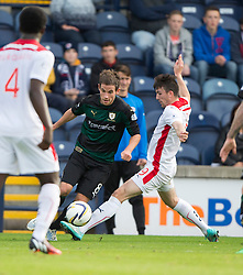 Raith Rovers Kevin Moon tackled by Falkirk's David Smith for a Raith Rovers penalty claim.<br /> Raith Rovers 0 v 0 Falkirk, Scottish Championship game played 27/9/2014 at Raith Rovers Stark Park.
