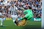 Dele Alli of Tottenham Hotspur gets a boot in his face from West Brom goalkeeper Ben Foster as the goalkeeper makes a save.  . Premier league match, West Bromwich Albion v Tottenham Hotspur at the Hawthorns stadium in West Bromwich, Midlands on Saturday 15th October 2016. pic by Andrew Orchard, Andrew Orchard sports photography.