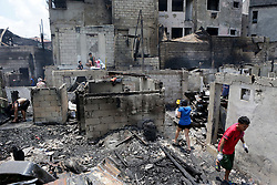 June 22, 2017 - Manila, Philippines - Residents look for reusable materials from their burnt home after a fire at a residential area in Manila, the Philippines. More than 100 shanties were razed in the fire, leaving 200 families homeless.  (Credit Image: © Rouelle Umali/Xinhua via ZUMA Wire)