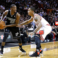 29 January 2012: Chicago Bulls point guard Derrick Rose (1) defends on Miami Heat point guard Norris Cole (30) during the Miami Heat 97-93 victory over the Chicago Bulls at the AmericanAirlines Arena, Miami, Florida, USA.