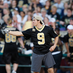 Apr 28, 2010; Metairie, LA, USA; Drew Brees (9) at bat during the Heath Evans Foundation charity softball game featuring teammates of the Super Bowl XLIV Champion New Orleans Saints at Zephyrs Field.  Mandatory Credit: Derick E. Hingle-US-PRESSWIRE.