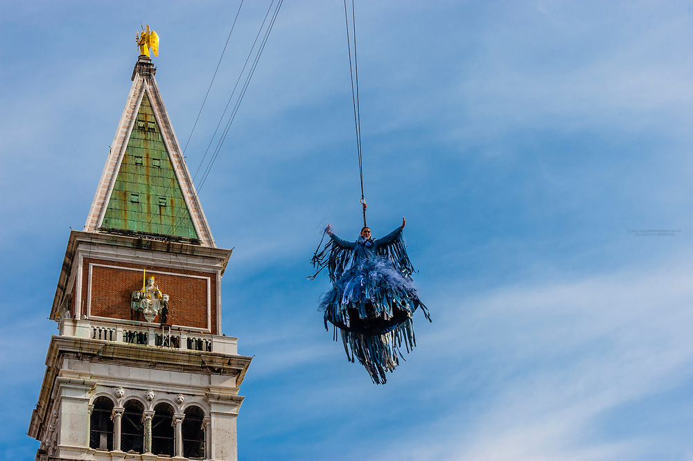 """The Flight of the Eagle (Volo Dell'Aquila), showgirl and actress Melissa Satta """"flies"""" down from the Campanile (Bell Tower) to a stage in Piazza San Marco during the Venice Carnival, Venice, Italy."""