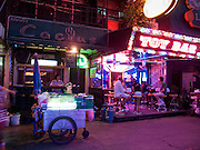 "Mar. 21, 2009 -- BANGKOK, THAILAND: A noodle cart does business with some of the workers on ""Soi Cowboy"" one of the adult entertainment districts in Bangkok, Thailand.    Photo by Jack Kurtz"