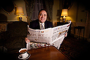 Scotland's First Minister Alex Salmond at Home at Bute House.<br /> 13/01/10.<br /> <br /> First Minister Alex Salmond at home at Bute House, Edinburgh<br /> <br /> <br /> Scotland's First Minister Alex Salmond at home at his residence Bute House in Edinburgh. The RHon Alex Salmond in 2007 realised his dream for Scotland as both He and the SNP swept to power in the Scottish Elections, defeating Labour and the Lib Dems, The SNP majority is 47 seats. Mr Salmond is also an MsP representing the constituency of Banff and Buchan and MP for Gordon. <br /> Although still committed to a fully independent Scotland, Salmond signed the SNP up to supporting the campaign for devolution, and, along with Scottish Labour leader Donald Dewar and Scottish Liberal Democrat leader Jim Wallace, played an active part in securing the victory for devolution in the Scotland referendum of 1997. However, many hard line fundamentalists in the SNP objected to committing the party to devolution, as it was short of full political Scottish independence.<br /> Salmond's first spell as leader was characterised by a moderation of his earlier left-wing views and by his firmly placing the SNP into a gradualist, but still pro-independence, strategy. Mr Salmond's patence and determination paid off in the end as he realised his dream and one would assume he will use this as a stepping stone to Scottish Independence.<br /> Alex is also a well known Hearts fan and admits his other dream was  realised seeing his team win the Scottish cup 2 times in recent years, in 1998 and 2006, He also for Children in Need 2008 performed an impersonation of Scottish Comic Lengend Rikki ~Fulton's the Rev I M Jolly.<br />  <br /> At Bute House, Edinburgh today.<br /> <br /> Picture by Mark Davison/ Universal News & Sport