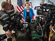 26 NOVEMBER 2019 - KNOXVILLE, IOWA: US Senator ELIZABETH WARREN (D-MA) talks to a reporters during a press gaggle after a campaign event in Knoxville Tuesday. Sen. Warren hosted a community meeting at the Sprint Car Hall of Fame and Museum in Knoxville, IA. She is running to be the Democratic candidate for the US Presidency in the 2020 election. Iowa hosts the first selection event of the presidential election season. The Iowa caucuses are February 3, 2020.                  PHOTO BY JACK KURTZ