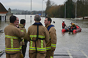 © Licensed to London News Pictures. 10/02/2014. Old Windsor, UK Flooding in OLD WINDSOR in Berkshire today 10th February 2014 after the River Thames burst its banks. The Environment Agency has issued 14 Severe Flood Warnings alone the Thames. Photo credit : Stephen Simpson/LNP