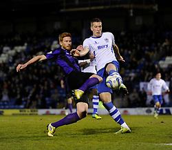 Bury's Jim McNulty clears the ball away from danger under pressure from Bristol Rovers' Matt Harrold - Photo mandatory by-line: Dougie Allward/JMP - Mobile: 07966 386802 01/04/2014 - SPORT - FOOTBALL - Bury - Gigg Lane - Bury v Bristol Rovers - Sky Bet League Two