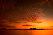 MEXICO, BAJA CALIFORNIA SOUTH Sea of Cortez near Loreto with the Isle del Carmen and the Isle Monserrat beyond at sunrise