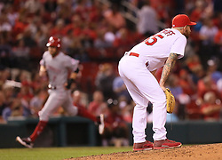 September 13, 2017 - St Louis, MO, USA - St. Louis Cardinals pitcher Ryan Sherriff reacts after giving up a grand slam to the Cincinnati Reds' Eugenio Suarez in the fifth inning on Wednesday, Sept. 13, 2017, at Busch Stadium in St. Louis. The Reds won, 6-0. (Credit Image: © Chris Lee/TNS via ZUMA Wire)