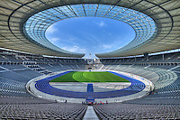 The Olympic Stadium was built for the 1936 Summer Olympic Games, after the International Olympic Committee (IOC) had chosen Berlin in 1931 to host the 1936 Games. Hitler took advantage of the opportunity provided by the Games to present a propagandistic image of National Socialist Germany to the world. For the duration of the Olympic Games, for instance, signs forbidding Jews to sit on park benches were removed so as not to detract from the Third Reich's portrayal of itself. The construction carried out for the Olympics was the Third Reich's first large architectural project. At one side of the stadium, the main axis is expressed by two identical towers. They indicate the main entrance. The Olympic rings are suspended between the towers to symbolically complete the design of the portal. At the other side of the stadium, the continuity of the tiers along the elliptical perimeter is suddenly interrupted by the 'Marathon Gate'. It is defined by two robust blocs that served to welcome the Olympic flame. The axis subsequently culminates with the 'Führerturm' which is the highest tower in front of the Marathon Gate. It heightens 75 meters (246 feet).