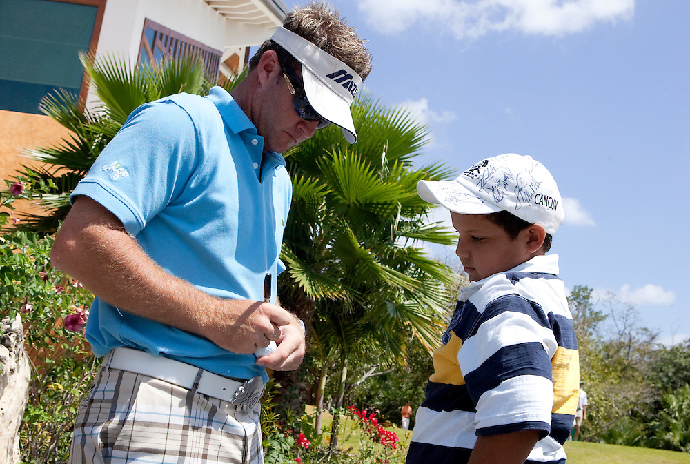 PGA Tour player Brian Gay signs autographs after a round at the Mayakoba Classic in Riviera Maya, Mexico.
