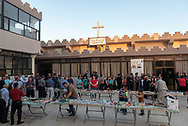 Iraqi Christians prepare to share a meal together in the courtyard of Saint John the Baptist Church (Ancient Church of the East) in Kirkuk, Iraq. (May 21, 2017)