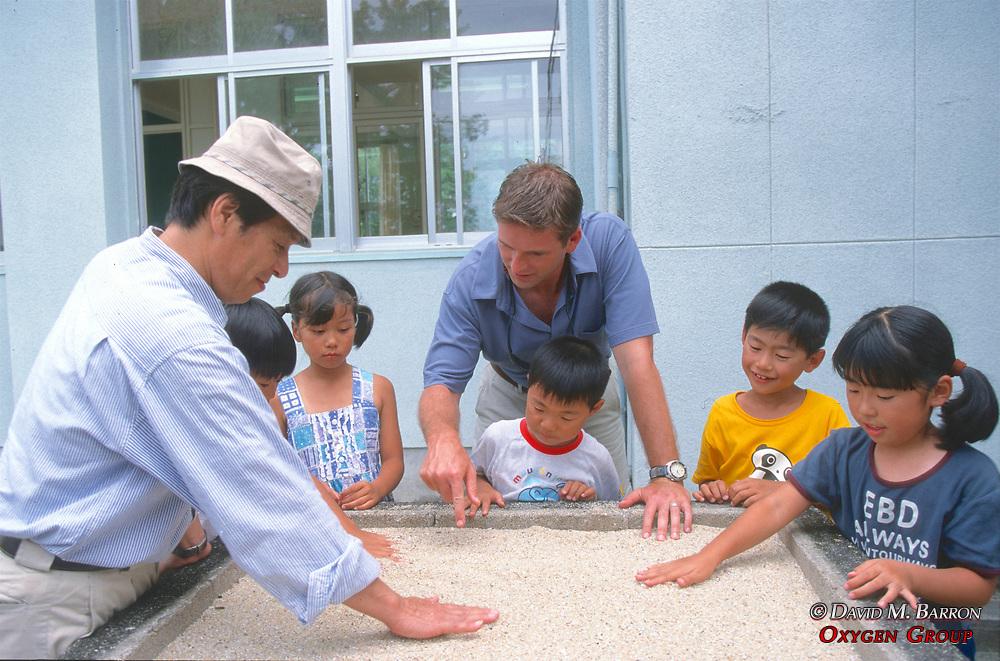 Kazuyoshi Omuta & J. Nichols With Students Learning About Nesting Sea Turtles