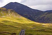 Car drives through the Glen Clunie hills and Grampian Mountains, Scotland, United Kingdom