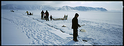 Inuit children fish for fjord cod in the first lead to open in the ice as spring moves towards summer in Siorapaluk, Greenland - the northernmost community on Earth.