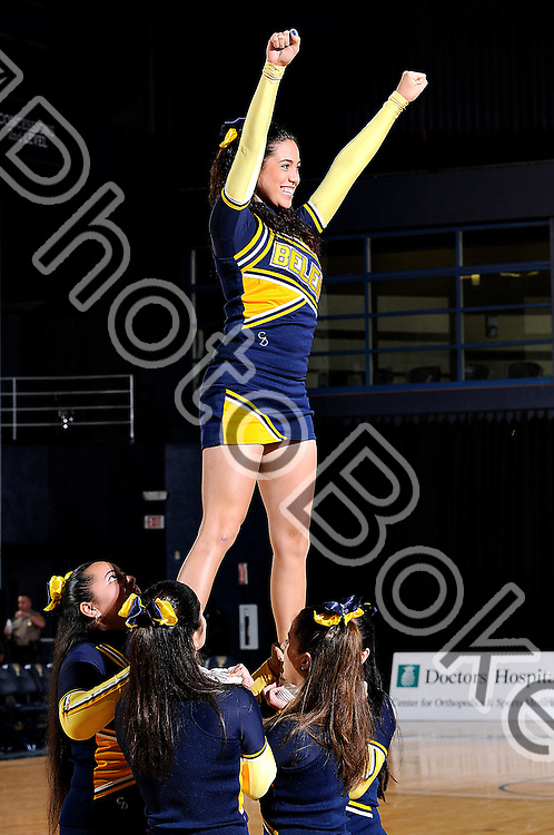 2012 January 13 - Belen's cheerleaders performing for the crowd. Belen Jesuit Wolverines variety basketball fell to the Columbus Explorers, 58-54, at the U.S. Century Bank Arena, Miami, Florida. (Photo by: www.photobokeh.com / Alex J. Hernandez) 1/250 f/6.3 ISO200 105mm
