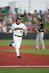 "1 June 2010: Phil Laurent heads for third base and bags a triple. The Windy City Thunderbolts are the opponents for the first home game in the history of the Normal Cornbelters in the new stadium coined the ""Corn Crib"" built on the campus of Heartland Community College in Normal Illinois."