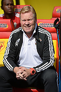 Ronald Koeman, the Southampton manager smiling in the dugout before k/o. Barclays Premier League, Watford v Southampton at Vicarage Road in London on Sunday 23rd August 2015.<br /> pic by John Patrick Fletcher, Andrew Orchard sports photography.
