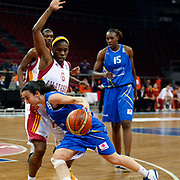 Galatasaray's Donneka HODGES (C) and Halcon Avenida's Sancho LYTTLE (R) during their woman Euroleague group C matchday 9 Galatasaray between Halcon Avenida at the Abdi Ipekci Arena in Istanbul at Turkey on Wednesday, January 12 2011. Photo by TURKPIX