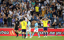 Scotland's Jon Soutattar (right) reacts after being shown a red card during the UEFA Nations League Group C1 match at the Sammy Ofer Stadium, Haifa.