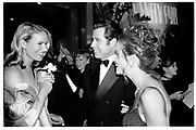 KELLY LYNCH; JOHN TRAVOLTA; KELLY PRESTON, Vanity Fair Oscar night party. Mortons, Los Angeles. 25 March 1996. SUPPLIED FOR ONE-TIME USE ONLY> DO NOT ARCHIVE. © Copyright Photograph by Dafydd Jones 248 Clapham Rd.  London SW90PZ Tel 020 7820 0771 www.dafjones.com