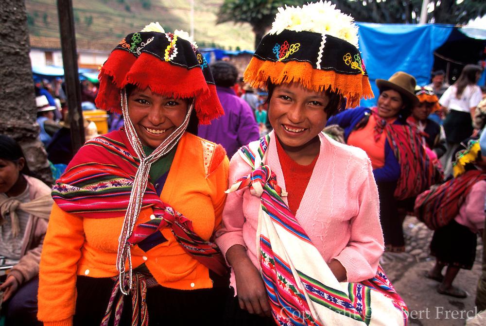 PERU, HIGHLANDS, MARKETS Pisac; Quechua girls at famous market