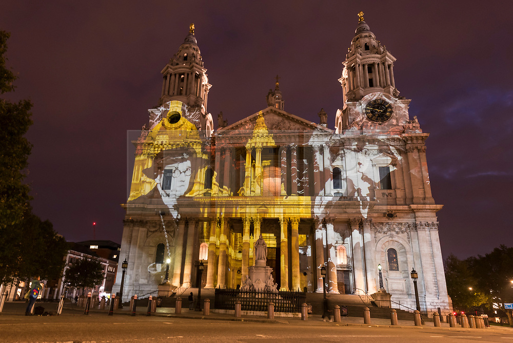 """© Licensed to London News Pictures. 23/10/2019. LONDON, UK.  Preview of """"Where Light Falls"""", a cutting-edge light show illuminating the facade of St Paul's Cathedral.  Along with poetry and sound, the show tells the story of the St Paul's Watch who ensured the survival of the Cathedral during the Blitz during the Second World War.  The event is open to the public on the evenings of the 24 to 27 October and is supported by Historic England.  Photo credit: Stephen Chung/LNP"""