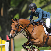 Sarah Segal riding Ubris in action during the $100,000 Empire State Grand Prix presented by the Kincade Group during the Old Salem Farm Spring Horse Show, North Salem, New York,  USA. 17th May 2015. Photo Tim Clayton