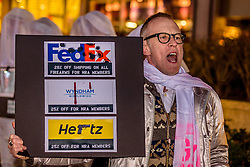November 28, 2016 - New York, United States - Protest at FedEx location in Midtown Manhattan - In a protest at FedEx, Hertz, and Wyndham Worldwide locations in Midtown Manhattan, Gays Against Guns, a direct action group committed to end gun violence in America, will demand that the three companies halt their generous discounts for NRA members because some of the money that NRA members save with FedEx, Hertz, and Wyndham ends up in the NRA's bank account. That same NRA bank account siphons money straight to the gun lobby's bank account. (Credit Image: © Erik Mcgregor/Pacific Press via ZUMA Wire)