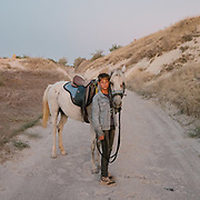 """A boy enjoys a horse ride in Cappadocia, meaning """"the land of the beautiful horse""""."""