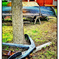 """An old anchor and 2 skiffs at Strawbery Banke Museum in Portsmouth, New Hampshire. iPhone photo - suitable for print reproduction up to 8"""" x 12""""."""