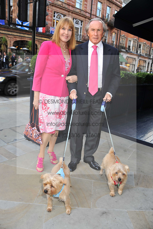 SIR JACKIE & LADY STEWART and their dogs Pimms & Whisky at the 10th anniversary of George in association with The Dog's Trust held at George, 87-88 Mount Street, Mayfair, London on 13th September 2011.