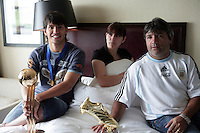 SERGIO KUN AGUERO - WORLD CUP U20 CHAMPION with ARGENTINA  - BEST PLAYER - and TOP SCORER with the trophy in his room, a day after win the final match over Czech Republic 2-1<br /> Here with his father LEONEL AGUERO - and his sister JESYCA.<br /> Toronto, Canada 23/07/07<br /> © Gabriel Piko / PikoPress