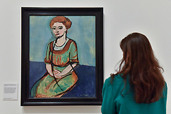 """© Licensed to London News Pictures. 01/08/2017. London, UK. A visitor views """"Portrait of Olga Merson"""", 1911.  Preview of """"Matisse in the Studio"""", at the Royal Academy of Arts, Piccadilly, the first exhibition to consider how the personal collection of treasured objects of Henri Matisse were both subject matter and inspiration for his work.  Around 35 objects are displayed alongside 65 of Matisse's paintings, sculptures, drawings, prints and cut-outs.  The exhibition runs 5 August to 12 November 2017.  Photo credit : Stephen Chung/LNP"""