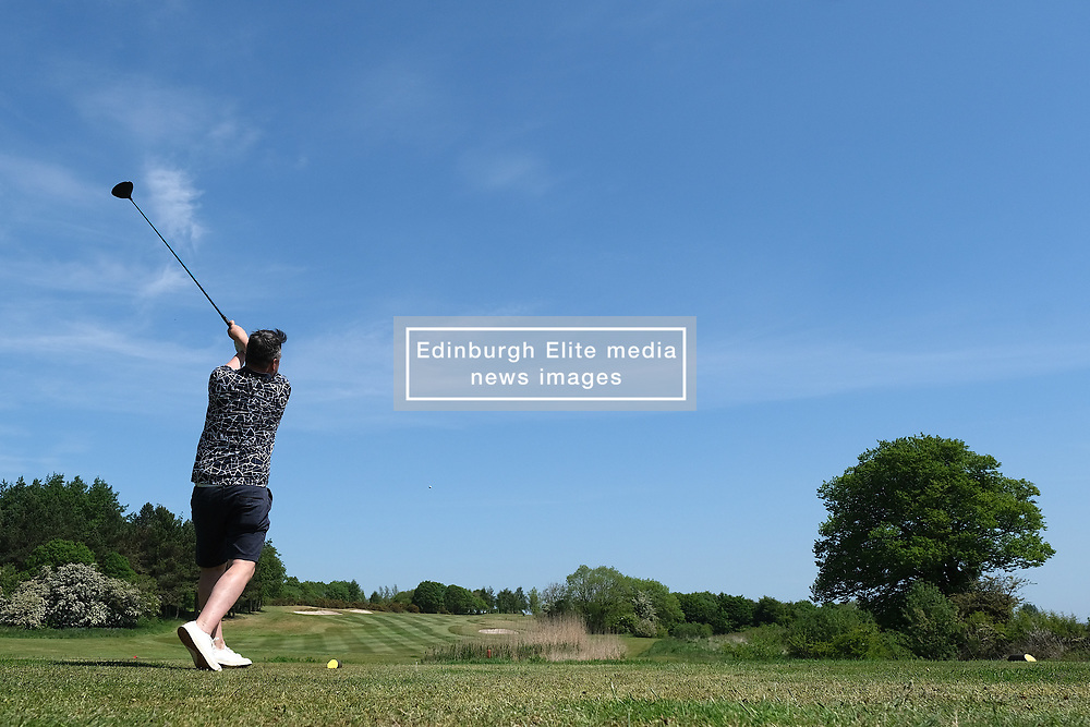 Scottish Golfers Back On The Course, Pumpherston, 29 May 2020<br /> <br /> Golf was one of the activities that were eased during phase one of lockdown restrictions in Scotland today, as long as social distancing rules were observed.<br /> <br /> Golfers at Pumpherston Golf Club in West Lothian were quick to take  advantage of the new rules.<br /> <br /> Pictured: Club member Stuart Gowans tees off at the third<br /> <br /> Alex Todd   Edinburgh Elite Media