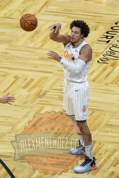 ORLANDO, FL - MARCH 23:  Aaron Gordon #00 of the Orlando Magic controls the ball against the Denver Nuggets at Amway Center on March 23, 2021 in Orlando, Florida. NOTE TO USER: User expressly acknowledges and agrees that, by downloading and or using this photograph, User is consenting to the terms and conditions of the Getty Images License Agreement. (Photo by Alex Menendez/Getty Images)*** Local Caption *** Aaron Gordon